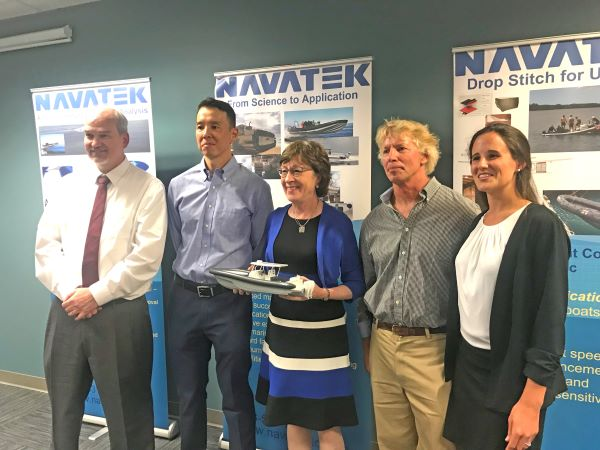 Maine Senator Susan Collins with representatives from Navatek and Front Street Shipyard