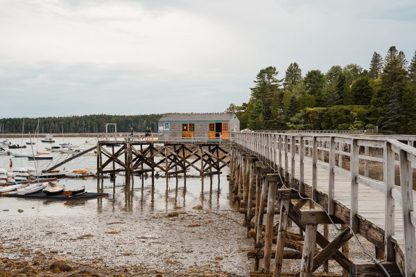 Wharf with dock house at low tide
